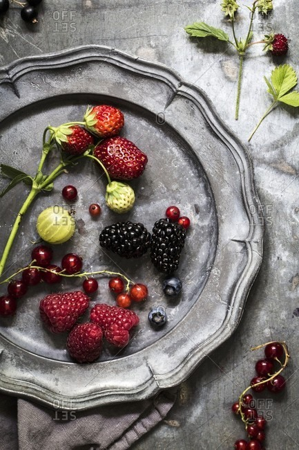 Strawberries, gooseberries, currants, blueberries, and raspberries on a tin plate