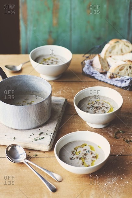 Wild mushroom soup with fresh thyme and crusty sourdough bread