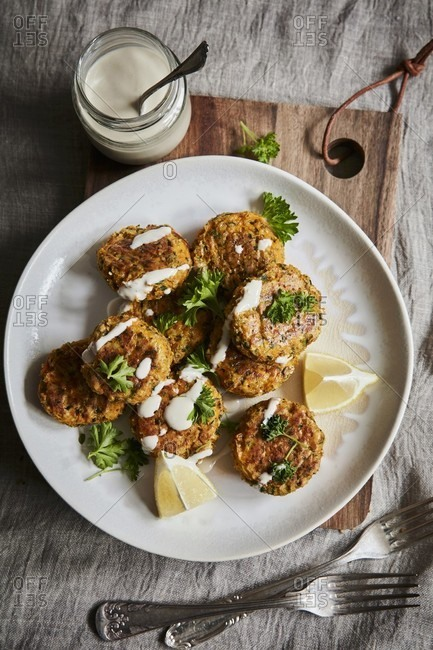Carrot patties with ginger, herbs and drizzled lemon tahini dressing