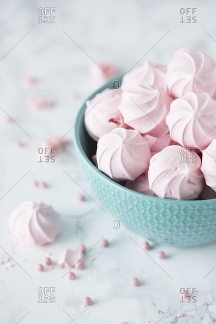 Pink mini meringues in a bowl