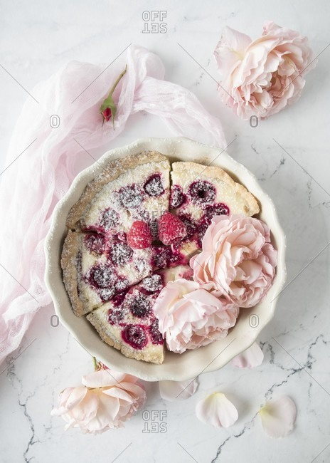 A raspberry tart with roses