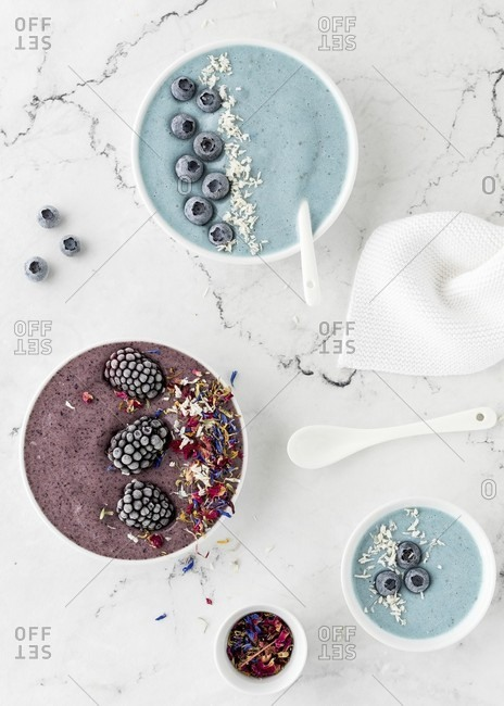 Bowls of blue and purple 'nice cream' (ice cream alternative)