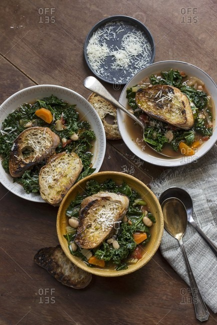 Ricollita soup with kale, carrot, tomatoes, parmesan and bread (Tuscany)
