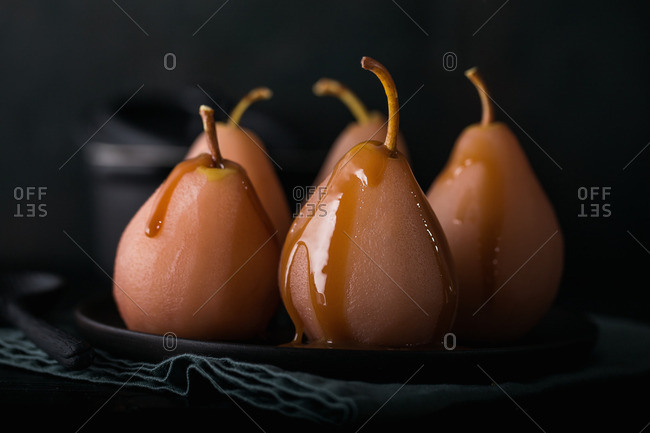 Christmas Pears.Pears Cooked In Red Wine With Caramel Sauce For Christmas
