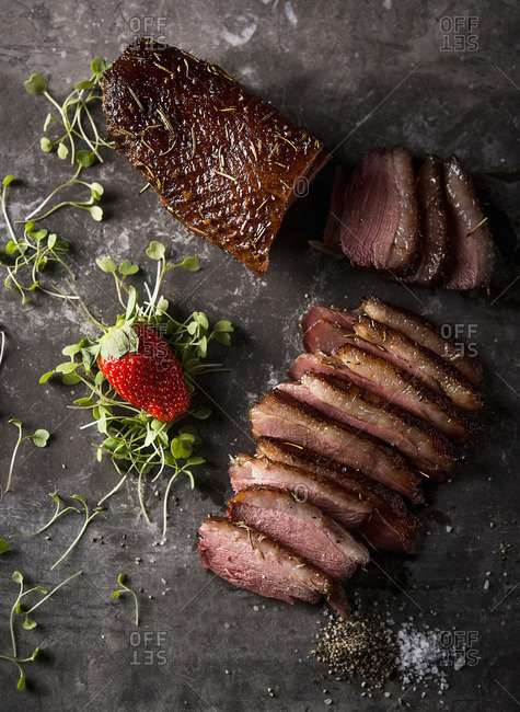 Duck breast with cress and a strawberry