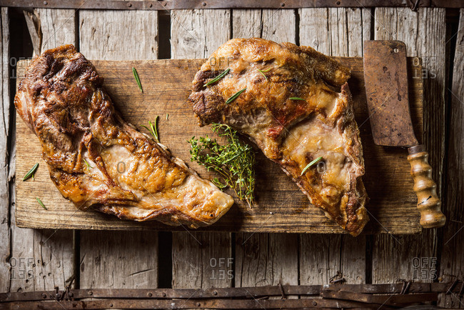 Entrecote with thyme on an old wooden board