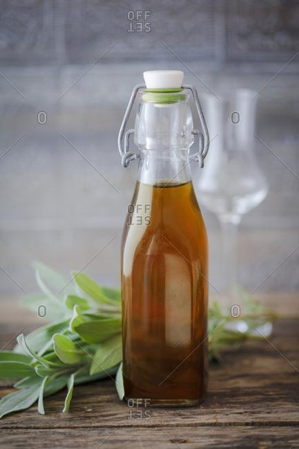 Sage liqueur in a flip-top bottle