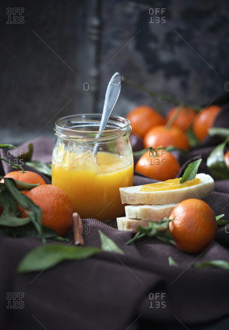 A jar or mandarin jam and fresh fruit
