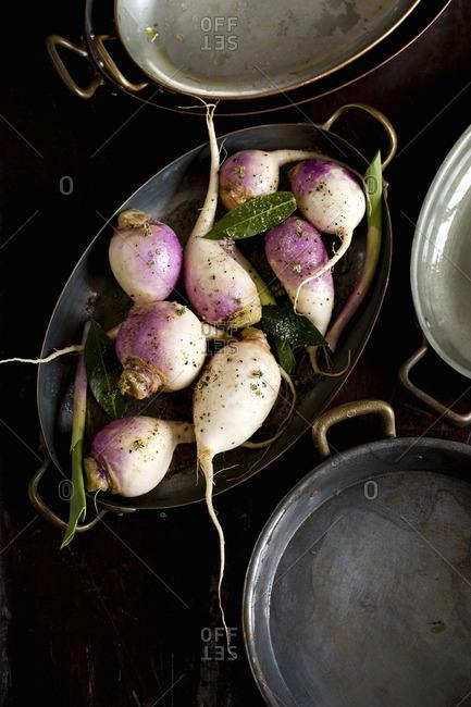 Raw turnips in a roasting pan