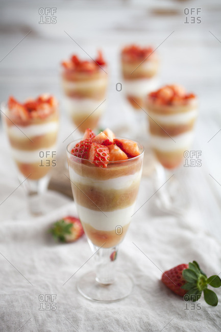 Creamy layered desserts with strawberries and rhubarb