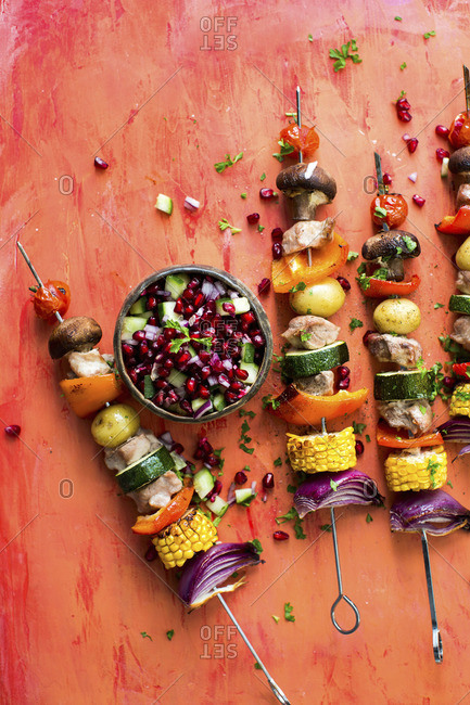 Pork and vegetable kebabs with pomegranate salsa