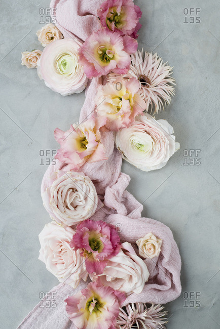 Arrangement of pink flowers on grey surface