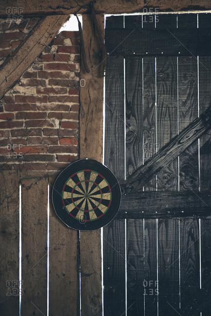 Dart board in an old barn