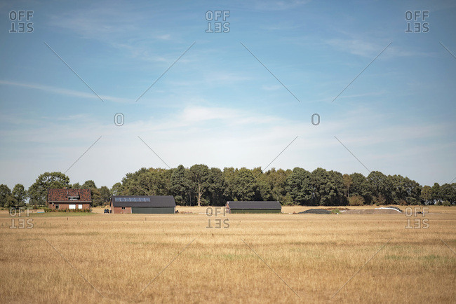 Rural field with farm buildings