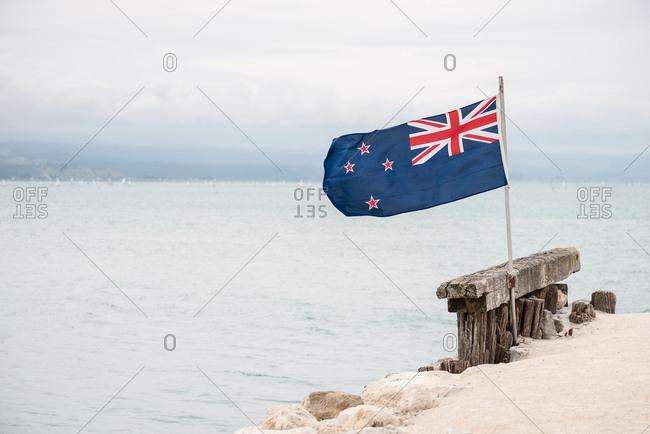 New Zealand flag flying on the coast