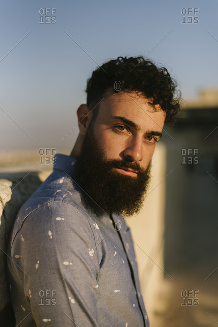 Portrait of a young handsome bearded man