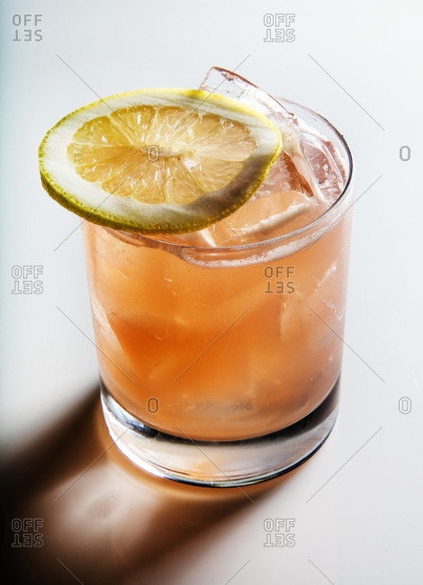 Fruity drink garnished with a lemon slice