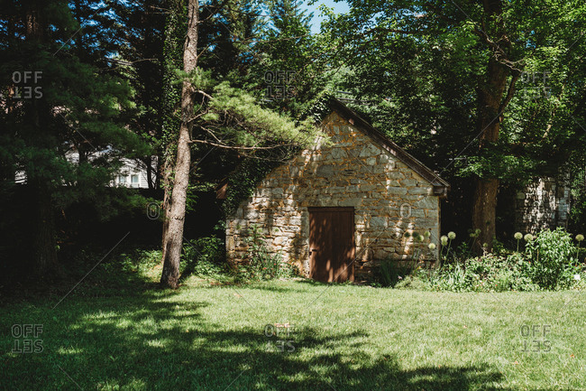 Abandoned stone building surrounded by trees