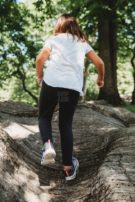 Girl running through the forest