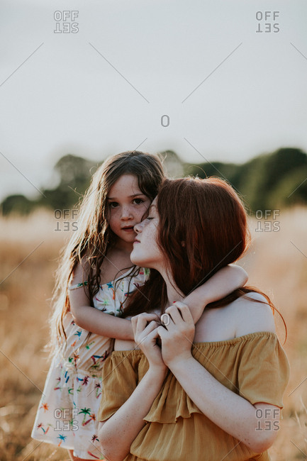 Sisters embraced in a field