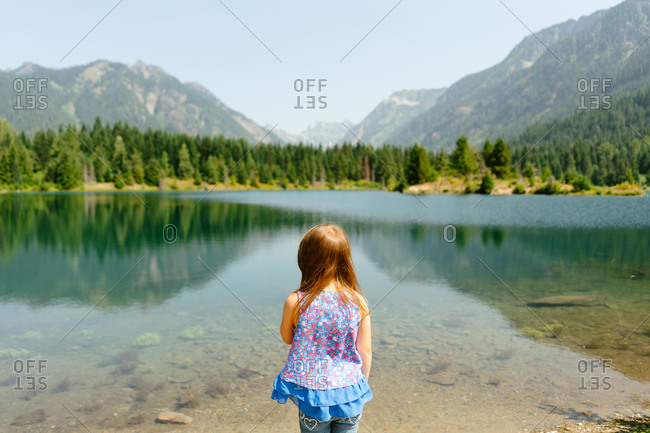 Little girl looking out at Gold Creek Pond in Washington