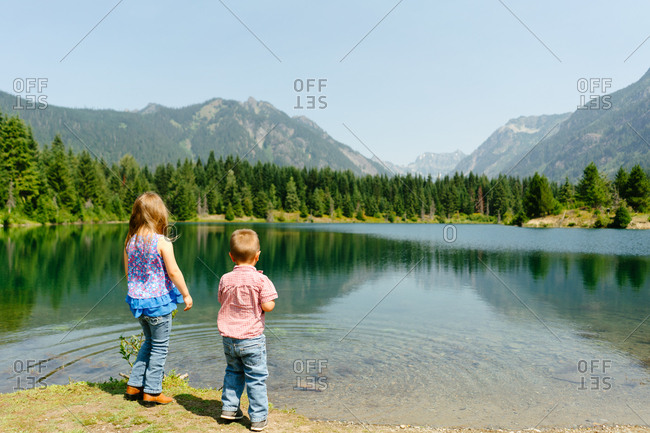 Two kids looking out at Gold Creek Pond in Washington