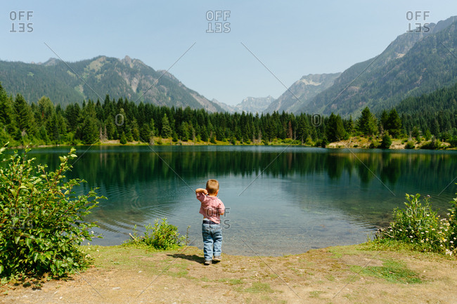 Little boy looking out at Gold Creek Pond in Washington