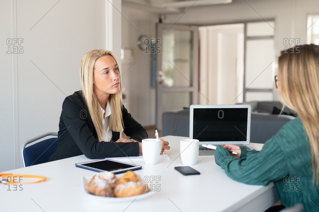 Two young businesswomen in a meeting