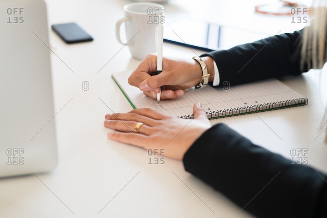 Businesswoman taking notes in an office