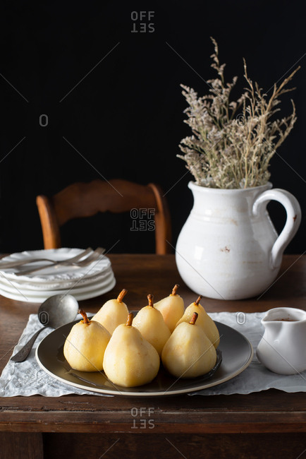 Poached Pears on a Rustic Farmhouse Table