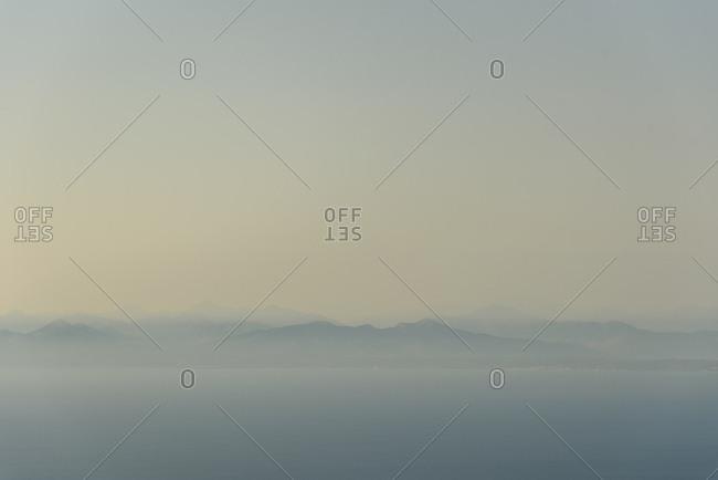 View across Ionian sea at twilight Lefkada island, Greece