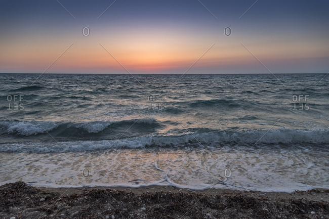 Beautiful sunset at Agios Ioannis beach Lefkada,Ionian sea, Greece