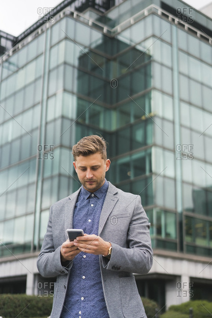 Young Businessman working Out door with Laptop and Mobile Phone