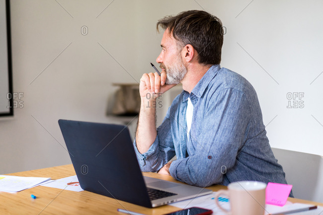 Man listening to speech in office