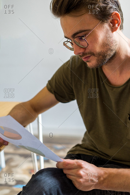 Young man looking diagrams in conference room