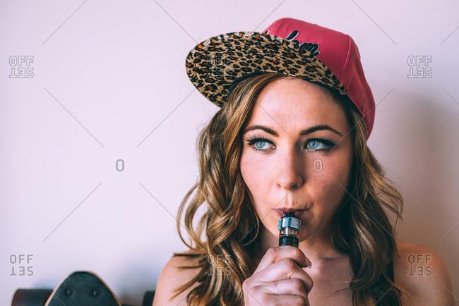 Skater woman smoking a cannabis joint