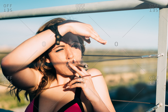 Young woman smoking a cannabis joint