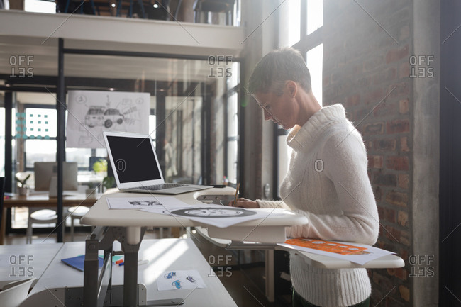 Businesswoman looking at sketch in office