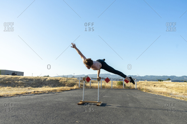 Acrobat balancing on handstand canes