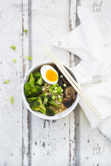 Bowl of Ramen soup with egg- broccoli- noodles- shitake mushroom and spring onions