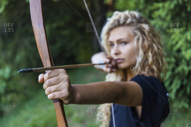 Archeress aiming with her bow- close-up