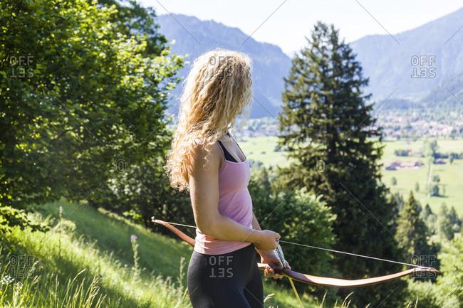Germany- Oberammergau- Reichenwies- archeress with her bow