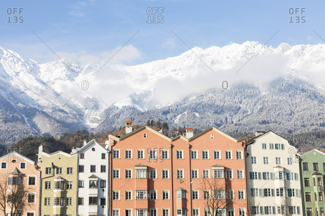 Austria- Innsbruck- row of houses in front of Nordkette Mountains