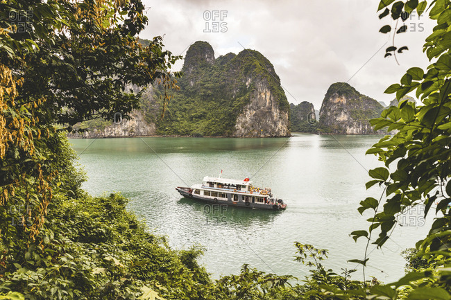 Vietnam- Ha Long bay- with limestone islands and excursion boat