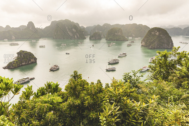 Vietnam- Ha Long bay- with limestone islands and tour boats