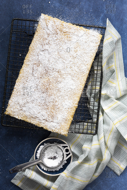 Lemon slice covered with sifted icing powder