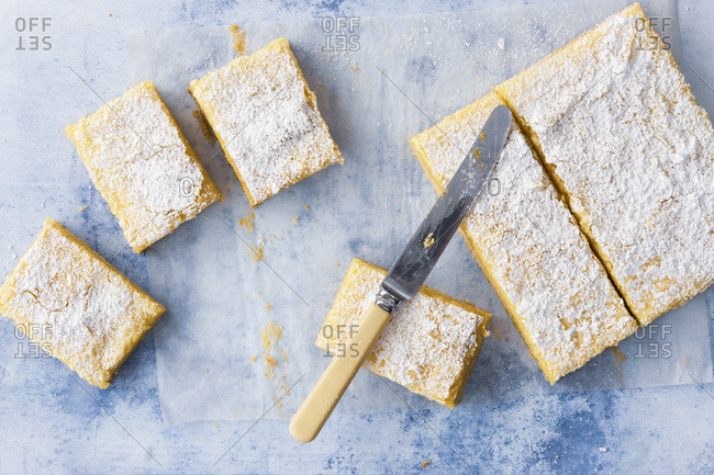 Homemade lemon slice dusted with icing sugar and cut into pieces
