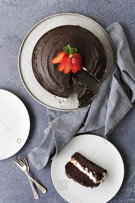 Gluten-free chocolate dessert cake with a slice of cake on a plate