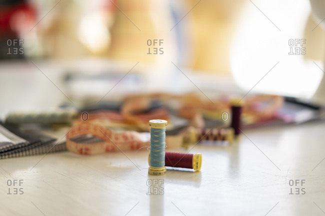 Sewing items on working table in a fashion designer's studio