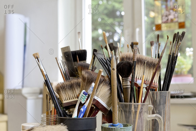 Assortment of brushes in a workshop